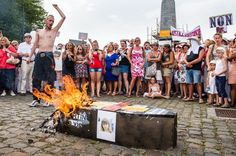 Brussels, Belgium Aug. 19, 2012 - People shout slogans as they gather around a burning mock coffin during a march to remember the victims of Belgium's child killer Marc Dutroux. (AP Photo/Geert Vanden Wijngaert)