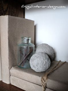 "Old books wrapped in brown paper and bound with twine.  An old found bottle is filled with a few old, rusty nails.  Free, ""Restoration Hardware"" inspired decor."