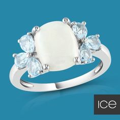 icy blue topaz & opal ring.....I would prefer pink stones though..