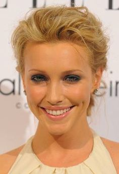 """""""Katie Cassidy is simply gorgeous and this look is great on her, but if she had a super long face, her hairstyle here would lengthen it. You don't want to add height at the top of the head. If you want to pull hair back, do so without creating volume at the crown. Part hair sideways and sweep hair across the forehead."""""""