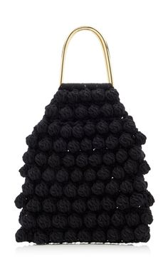 This **Ulla Johnson** tote is rendered in cotton and features hand crochet bobble and a top handle.