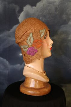 DO NOT BUY except for Judith- this is the price of last layaway payment. Amazing! Stunning cloche hat in excellent condition in a rare larger size. Will fit up to a 23 head but worn snugly, close to the head and low on the brow as it is meant to. In a rare lighter tan color, perfect for a hot Summers Day or the Gatsby picnic in northern California. Flowers are expertly embroidered on as to seem part of the tight straw weave itself. Lovely colors. Gorgeous label. Only the silk lining could…