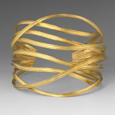 Make an outstanding statement of sophisticated beauty with this Barbara Heinrich cuff bracelet. The eight ribbons of 18K yellow gold flow freely along your wrist, and dance gracefully in form. This piece is entirely glamorous and majestic in its organic presence!