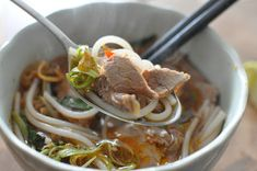 Oxtail and pig's trotter noodle soup with fragrant lemongrass, beef, banana blossom and hot mint. Originates from Hue, The Central Highlands – where my grandmother comes from. Some would favourite this noodle soup over Pho.  This is what my grandmother used to make in Saigon, in the front entrance of our house. It was a time after the war in the late seventies. The communists took away everything anyone had. My uncle had been captured when he ...