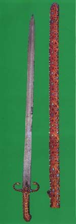 "al-Ma'thur al-Ma'thur, also known as ""Ma'thur al-Fijar"" is the sword which was owned by the prophet Muhammad before he received his first revelations in Mecca. It was willed to him by his father. The prophet Muhammad migrated with the sword from Mecca to Medina, and the sword remained with him until it was transferred, along with other war equipment, to Ali b. Abi Talib.  The blade is 99 cm in length. The handle is of gold in the shape of two serpents, and is encrusted with emeralds and…"