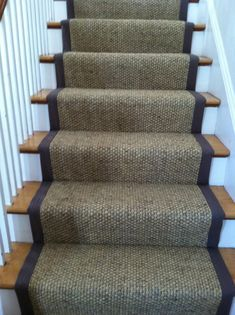 "This is a #sisal_carpet remnant custom cut and fabricated with a 3"" wide binding. This was a custom installation on a straight set of stairs by The Carpet Workroom #sisal_stair_runner"