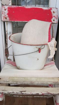 Vintage  enamel white and red  bucket ~ This so much reminds me of the chair and pail in my grandparent's basement (only her chair was all white).
