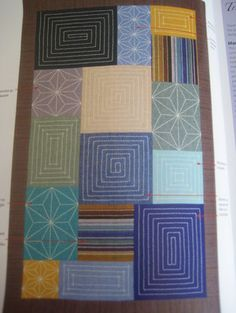 "a sashiko sampler from Susan Briscoe's book ""Japanese Sashiko Inspirations"""