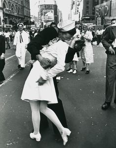 Alfred Eisenstaedt  The V-J Day Kiss in Time Square  i absolutely love this picture! it was truely a once in a life time moment to capture such a great picture.