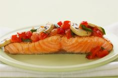 Zesty Italian Baked Salmon  4 salmon fillets 1-1/4#  1/3 cup  VIVA Italian Dressing  1  tomato chopped  1/2 cup  sliced mushrooms  3  green onions sliced  HEAT oven to 350° PLACE fish in baking dish spray w/cooking spray MIX remaining ingredients; spoon over fish. Cover with foil cut several slits in top of foil  BAKE 20-25 min or until flakes easily.   Thinly slice 4 med red potatoes & toss w/packet of  Zesty Italian Dressing Mix. Place in baking pan spray w/cooking spray Bake w/fish