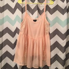 NWOT Torrid Peach Lace Babydoll Tank Top Size 2X NWOT Torrid Peach Lace Babydoll Tank Top Size 2X. Comes from a smoke free home. Let me know if you have any questions! torrid Tops Tank Tops