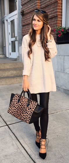 Oversized sweater, shiny leggings, and strappy black heels... LOVE! ❤