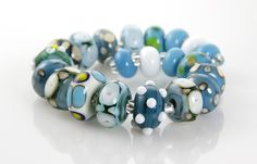 Premium handmade dark turquoise lampwork glass beads. This lampwork bead set, features 21 beads, includes a little bit of every style from dots (raised and flat), swirls, floral and solid beads. Each
