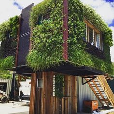 elevate overall solar tiny homes powered houses on wheels for sale puts green walled rainwater collecting house Wheels For Sale, House On Wheels, Home Greenhouse, Water Conservation, House Floor Plans, Backyard Landscaping, Landscaping Ideas, Solar Panels, Solar Power