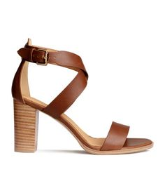 Sandals in imitation leather with an ankle strap with a metal buckle and rubber soles. Heel 9.5 cm.