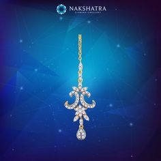 A striking diamond maangtika from Nakshatra for the crowning jewel on the bride.Just like a spectacular star in the heavens.  #maangtika #Nakshatra #stars #bride #diamondjewellery #jewellery #nakshatraworld #divine #bridaljewellery #Jewel #crown #accessory #hairaccessory