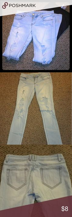 Distressed Skinny Jeans Size 3. Light colored distressed skinny jeans. Worn look style. Small mark on bottom of front side of leg - shown in photo. Brand : Missimo. Jeans Skinny
