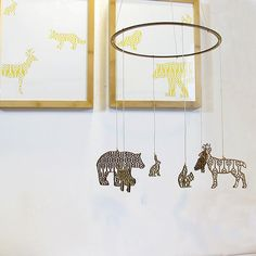 A mobile of whimsical wooden animals has an appealingly modern style.