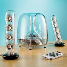 Harmon Kardon - still some of my favorite speakers both aesthetically, and aurally.  Love them.  The Resonating Transparent Speakers