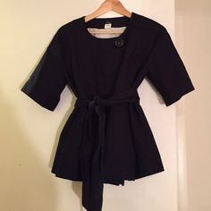 J. Crew Navy Jacket Navy belted short sleeve jacket, with large top button. Fully lined with satin pin stripes and fuchsia sleeves. Beautiful jacket that can be worn year round whether for work in the Winter or light jacket for Spring. J. Crew Jackets & Coats