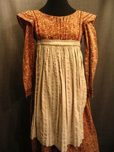 Girl's 19th century tan rose orange floral print cotton dress and beige striped apron