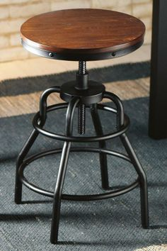 he Industrial Mansard Stool is durably crafted of metal with an adjustable height of 23.5 to 31.The unique stool design is the perfect transitional addition to a home office or kitchen. Add industrial style to your home and order yours today.