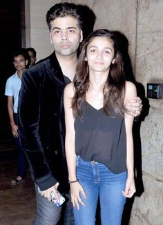 Karan Johar and Alia Bhatt at Brothers screening.