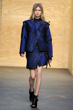 Proenza Schouler Fall 2012 RTW.  It was a tough-girl collection that unexpectedly veered into an Asian theme with floral and bird motifs on halter dresses and jackets. It almost read like a narrative about a Japanese warrior, from his armor to his ceremonial robes.