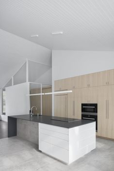 Montreal architecture studio Naturehumaine has transformed a local residence with a new grey exterior and pared-down interior. Modern Kitchen Design, Modern Interior Design, Prairie House, Interior Minimalista, Grey Exterior, Floor Layout, Big Design, Minimalist Interior, Architecture Design