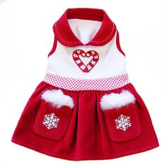 The Snow Drop dress features luxurious soft red velvet skirt with two snowflake decorative pockets.  A custom crystal candy cane appliqué complete this Holiday's theme apparel. Proudly made in the U.S.A.