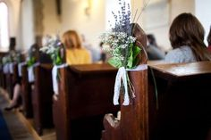 Clever idea for DIY ceremony decorations. Simple arrangement tied on with lace.