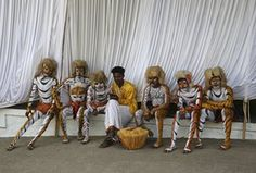 Performers take a break after their show at the Pravasi Bharatiya Divas event, which marks the contribution of the overseas Indian community to the development of India.