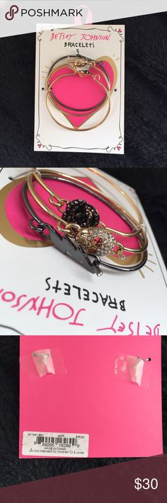 Betsey Johnson Bracelet Set This set of bracelets features a gold rhinestone skull, a blackish rhinestone rose, and a dark silver metal lightning bolt. Never been opened or worn. Betsey Johnson Jewelry Bracelets