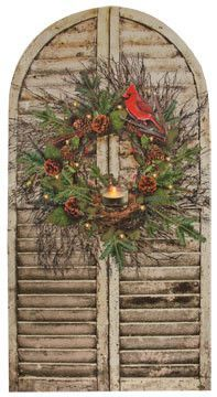 Christmas Shutter Lighted Canvas is shaped just like a pair of rustic shutters, with a country pine wreath with a cardinal print and a tealight candle. The tealight candle is lit from behind with a fl