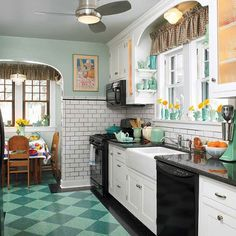 A ca. 1930 kitchen is perfect for this house—and the backdrop for its owners' collection of blue-green ceramics.