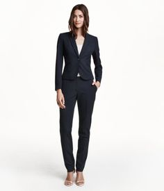 Suit pants in woven stretch fabric with tapered legs, side pockets, and one welt back pocket. Hook-and-eye fastener.