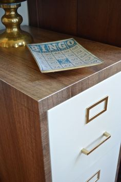 file cabinet makeover with contact paper, chalk paint and gold paint for hardware.