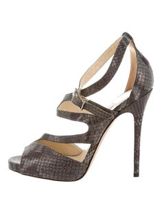 Charcoal and grey metallic canvas Jimmy Choo cage sandals with tonal stitching throughout, covered heels and gunmetal buckle closures at ankles. Caged Sandals, Jimmy Choo, Metallic, Shoe, Candy, Ankle, Heels, Women, Fashion