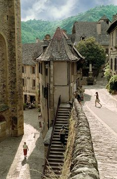 Multiple street levels offer tourists a better view of villiage in Conques, France