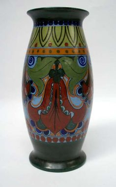 A polychrome decorated pottery vase, marked Nijmegen Holland, ca. 1920