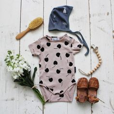 Cherry Onesie & Fish bonnet - Fin & Vince. Humble hilo baby sandals, nomilumade wooden pacifier clip, murlife heirloom wooden hair brush. Organic kids and baby clothing.
