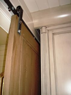 pocket barn door. great rustic trim!