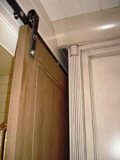 pocket barn door. great rustic trim!