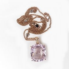A 14ct rose gold kunzite and diamond pendant a 14.00ct cushion cut, peach pink kunzite, claw set and suspended from… / MAD on Collections - Browse and find over 10,000 categories of collectables from around the world - antiques, stamps, coins, memorabilia, art, bottles, jewellery, furniture, medals, toys and more at madoncollections.com. Free to view - Free to Register - Visit today. #Jewelry #Chains #MADonCollections #MADonC