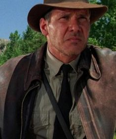 Indiana Jones and the Last Crusade - Publicity still of Harrison Ford Indiana Jones Jacket, Harrison Ford Indiana Jones, Indiana Jones Films, Henry Jones Jr, Adventure Movies, Steven Spielberg, Cool Hats, Movie Stars, Indie