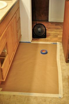 Restain with gel stain...you don't have to sand as much. READ THIS ARTICLE FOR THE KITCHEN
