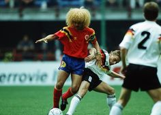 MILAN, ITALY - JUNE 19: Carlos Valderrama of Colombia and Thomas Haessler of Germany in action during the World Cup match between Germany and Colombia on June 19, 1990 in Milan, Italy. (Photo by Bongarts/Getty Images)