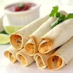 Baked Creamy Chicken Taquitos - The Girl Who Ate Everything