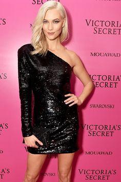 Major comeback! Karlie Kloss in a RTA long-sleeved one shoulder dress..