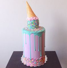 Over-the-top cakes will always impress. Pinned: 2,261 times to date Recipe: Upside Down Ice Cream Cone Cake   - TownandCountryMag.com